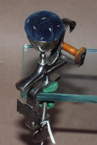 Antique Polished Steel Figural Sewing Clamp w/ Pincushion& Winder
